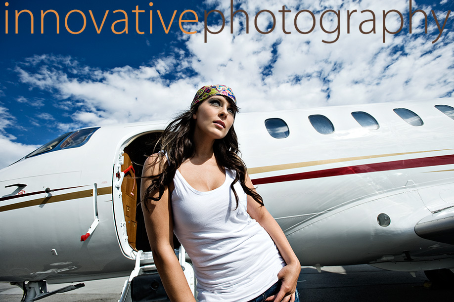 Beautiful woman with a private jet